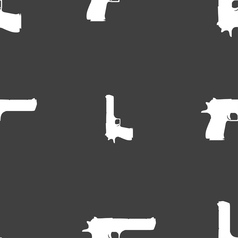 Gun icon sign seamless pattern on a gray vector
