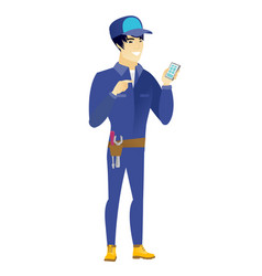 asian mechanic holding a mobile phone vector image