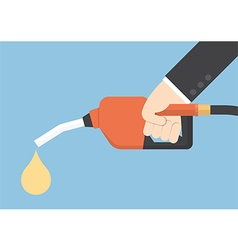 Hand holding gas fuel pump nozzle vector