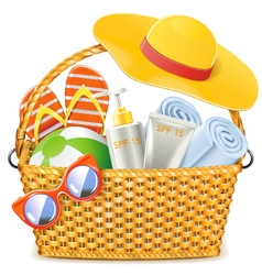 Wicker basket with beach accessories vector