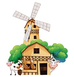A barn at the farm with animals vector