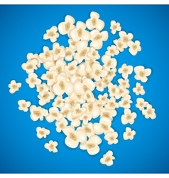 Heap popcorn for movie lies on blue background vector