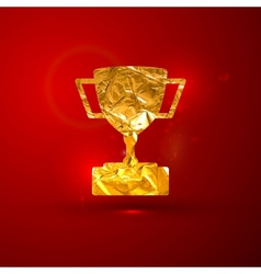 A golden metallic foil champions cup on t vector