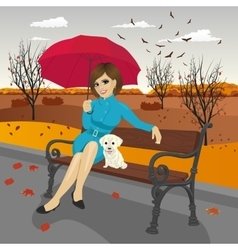 Young woman in blue autumn coat with umbrella vector