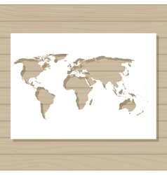 Stencil template of world map on wooden background vector