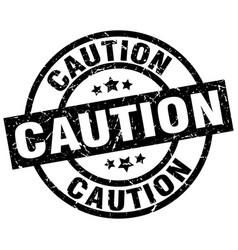 Caution round grunge black stamp vector