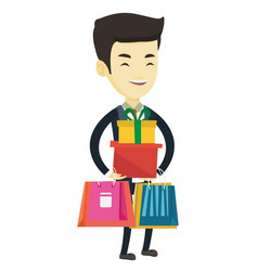Happy man holding shopping bags and gift boxes vector