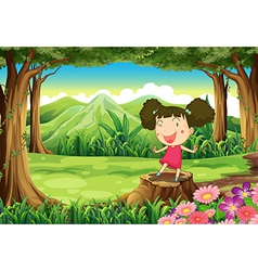 A cute little girl above the stump at the forest vector image