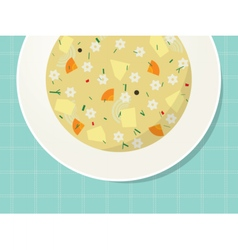 Plate with noodle and vegetable soup on the table vector