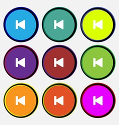 Fast backward icon sign nine multi-colored round vector