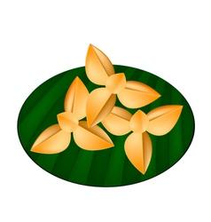 Thai shortbread cookies on green banana leaf vector
