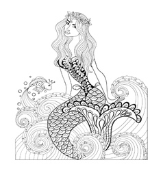 Fantastic mermaid in sea waves with a goldfish and vector