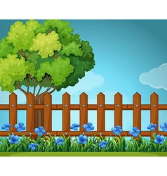 Scene with wooden fence in garden vector image vector image
