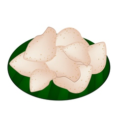 Thai rice crackers on green banana leaf vector