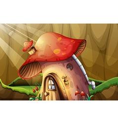 Mushroom house in the garden vector image
