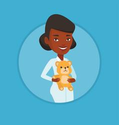 Pediatrician doctor holding teddy bear vector