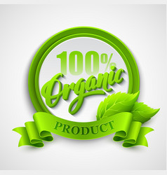 Organic emblem with ribbon and green leaves vector