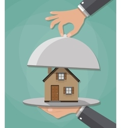Hand opens serve cloche with house inside present vector image vector image