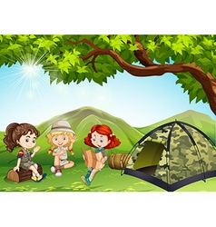 Three girls camping out in the field vector