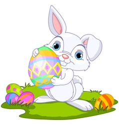 cute easter bunny carrying egg vector image vector image