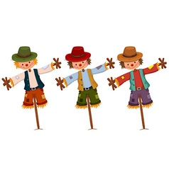 Three scarecrows on wooden sticks vector image