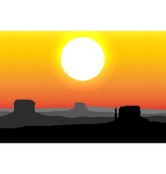 Monument valley arizona against a red sunset sky vector