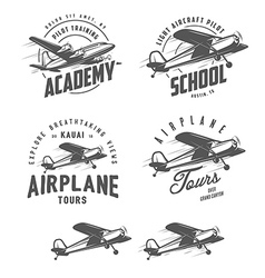 Light airplane related emblems and design elements vector