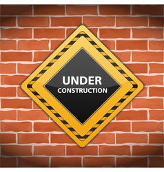 Under Construction Sign on Brick Wall vector image vector image