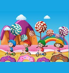 Children riding bike on beach full of candy vector