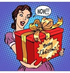 Woman with christmas gift vector