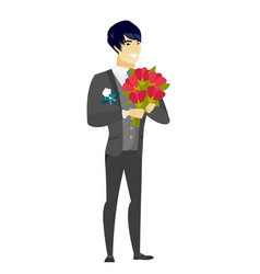 Asian groom holding a bouquet of flowers vector