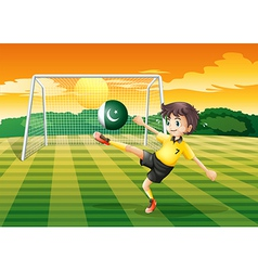 An athlete kicking the ball with the flag of vector