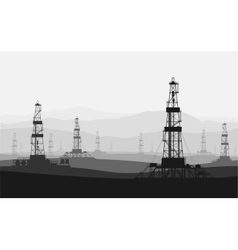 Oil rigs at large oilfield over mountain range vector