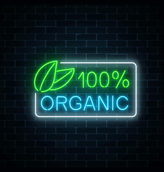 Neon 100 percent organic production sign on dark vector