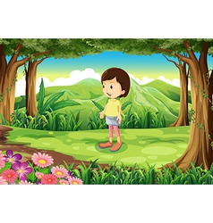 A little girl standing at the forest vector
