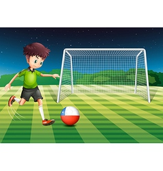 An athlete kicking the ball with the flag of chile vector