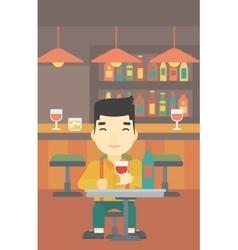 Man drinking wine at restaurant vector image