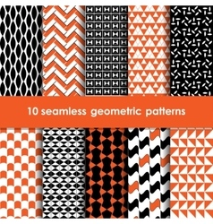 Geometric black orange and white seamless patterns vector