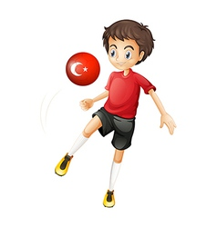 A boy using the ball with the flag of turkey vector