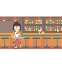 Woman drinking wine at restaurant vector