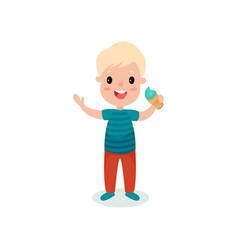 cute towheaded boy eating ice cream cartoon vector image vector image