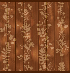 Silhouette of leaves flowers on wooden background vector