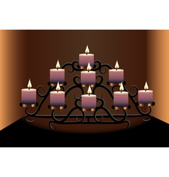 An old chandelier with candles vector