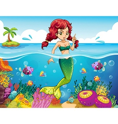 A sea with a mermaid vector image