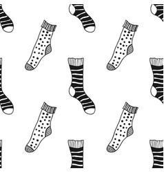 Seamless black white pattern of doddle socks for vector