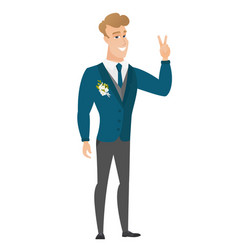 Caucasian groom showing the victory gesture vector