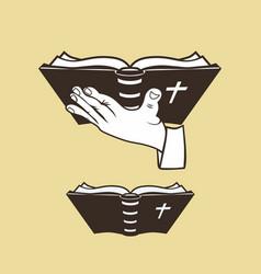 Bible in hand vector