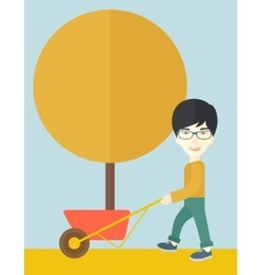 Young man pushing the cart with tree vector