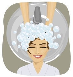 Young woman washing head at hair salon vector