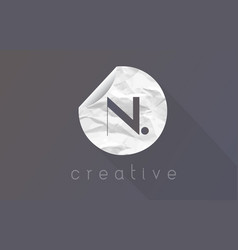 N letter logo with crumpled and torn wrapping vector